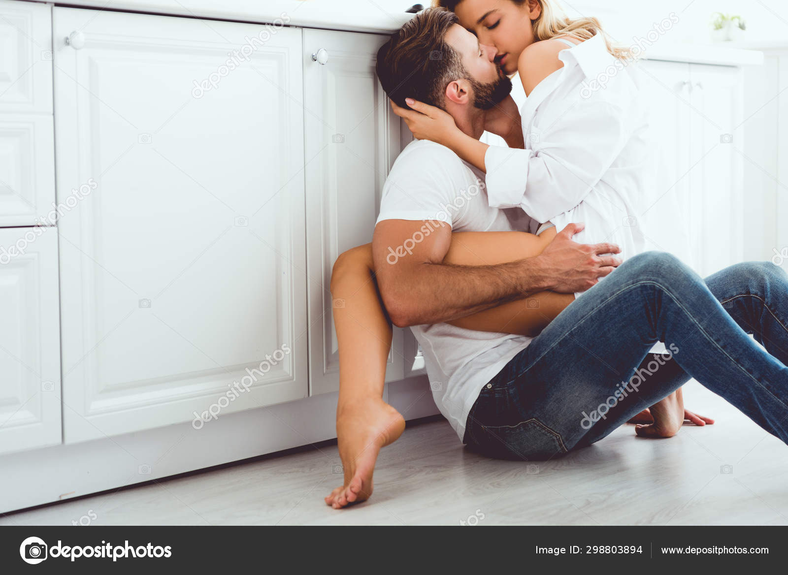 Young Couple Hugging Kissing While