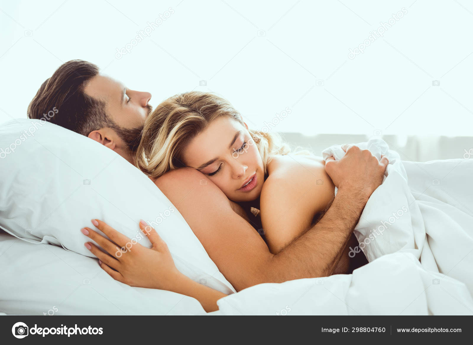 Happy Young Couple Hugging Closed Eyes While Lying Bed Stock Photo Image By Haydmitriy 298804760