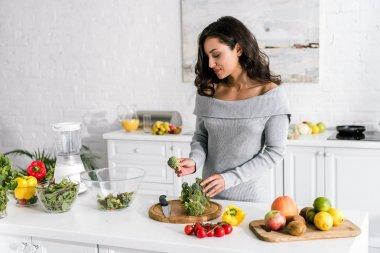 Young attractive woman preparing salad at home stock vector