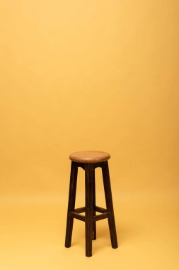 Brown wooden chair isolated on yellow stock vector