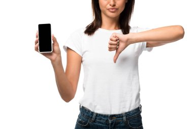 Cropped view of woman showing thumb down and smartphone with blank screen, isolated on white stock vector