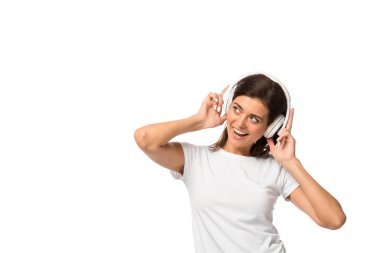 Cheerful young woman listening music with headphones, isolated on white stock vector