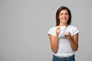 Beautiful smiling woman holding cup of coffee, isolated on grey stock vector