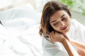 high angel view of attractive woman in white shirt looking away at morning