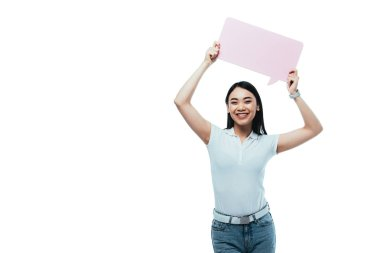 Happy attractive asian girl holding pink blank speech bubble isolated on white stock vector