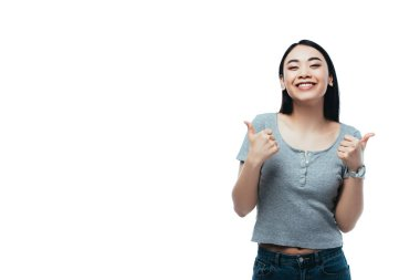 Happy attractive asian girl showing thumbs up isolated on white stock vector