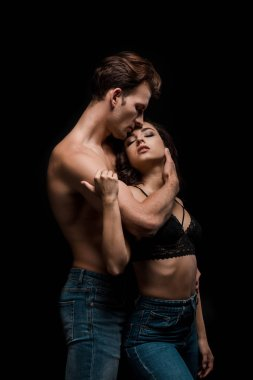 beautiful passionate couple hugging, isolated on black