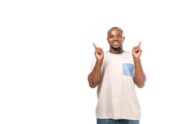 Cheerful african american man looking at camera and pointing with fingers isolated on white stock vector