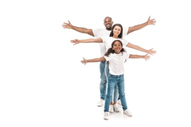 Cheerful african american family imitating flying with outstretched hands on white background stock vector