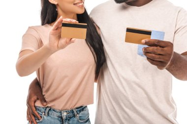 Cropped view of african american couple holding credit cards isolated on white stock vector