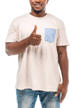 Cropped view of smiling african american man showing thumb up isolated on white stock vector