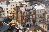 aerial view of old houses with rusty metallic roofs in historical center of lviv, ukraine
