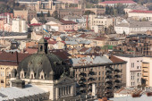 aerial view of city with roof of dominican church and old buildings in historical center