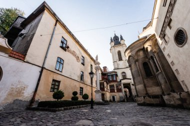 street with old houses leading to carmelite church in lviv, ukraine