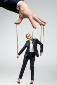 levágott kilátás báb tartó üzletasszony marionett húrok elszigetelt szürke