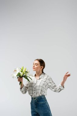 Pleased attractive girl posing like puppet with flowers isolated on grey stock vector