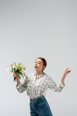 Happy attractive girl posing like puppet with flowers isolated on grey stock vector