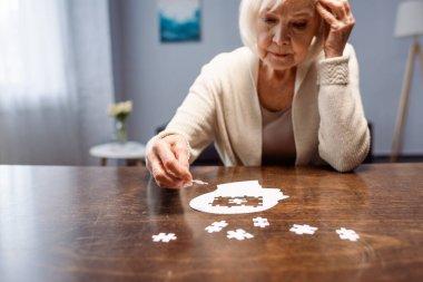 Senior woman combining jigsaw puzzle for dementia rehabilitation stock vector