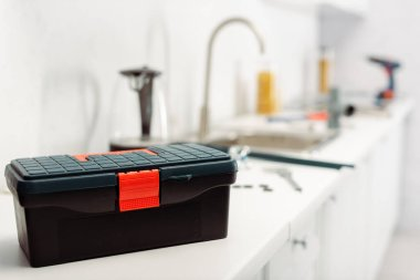 Selective focus of toolbox on worktop in kitchen stock vector