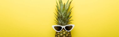 Top view of ripe pineapple in sunglasses on yellow background, panoramic shot stock vector