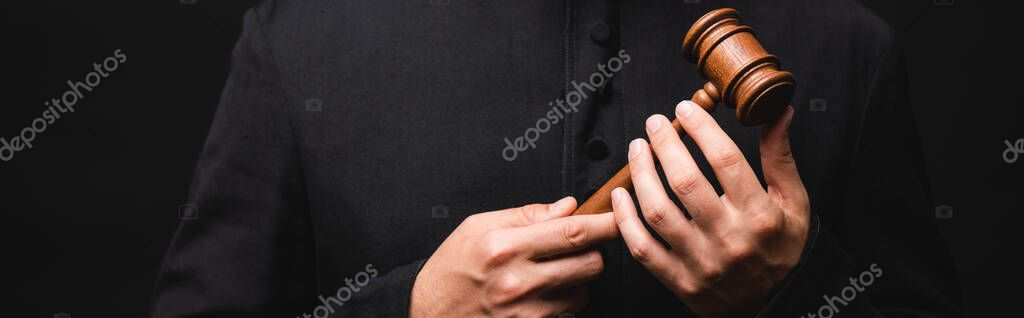 Panoramic crop of priest holding wooden gavel isolated on black stock vector
