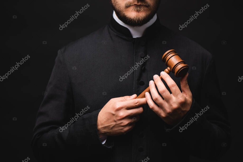 Cropped view of bearded priest holding wooden gavel isolated on black stock vector
