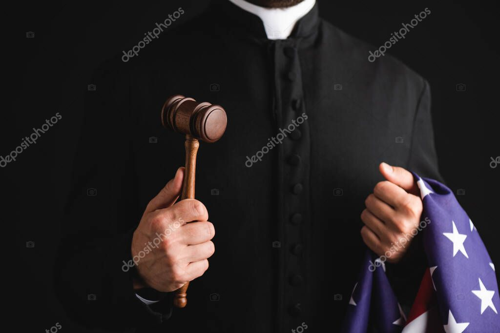 Cropped view of priest holding wooden gavel and american flag isolated on black stock vector