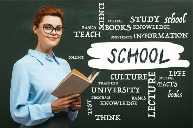 Teacher in eyeglasses holding book near chalkboard with lettering in classroom stock vector
