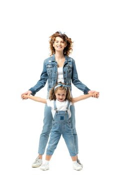 Mother and daughter in denim outfits posing and smiling isolated on white stock vector