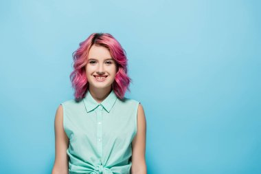 Young woman with pink hair smiling on blue background stock vector