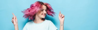 Young woman waving pink hair on blue background, panoramic shot stock vector