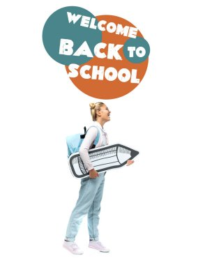 Child with backpack holding paper pencil near welcome back to school illustration on white stock vector