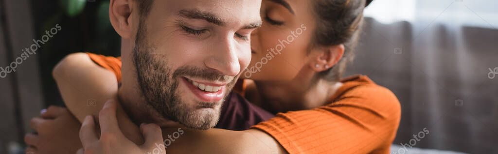 Tender woman embracing happy boyfriend and whispering in his ear, banner stock vector