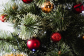 Close up view of pine with christmas balls and lights