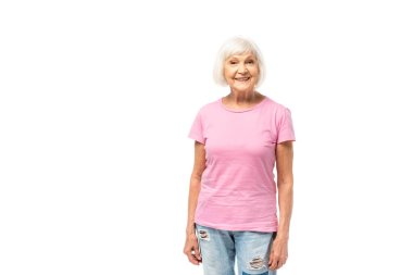 Senior woman in pink t-shirt looking at camera isolated on white stock vector