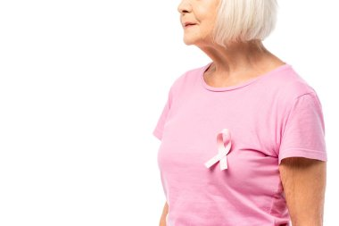 Cropped view of pink ribbon of breast cancer awareness on t-shirt on senior woman isolated on white stock vector