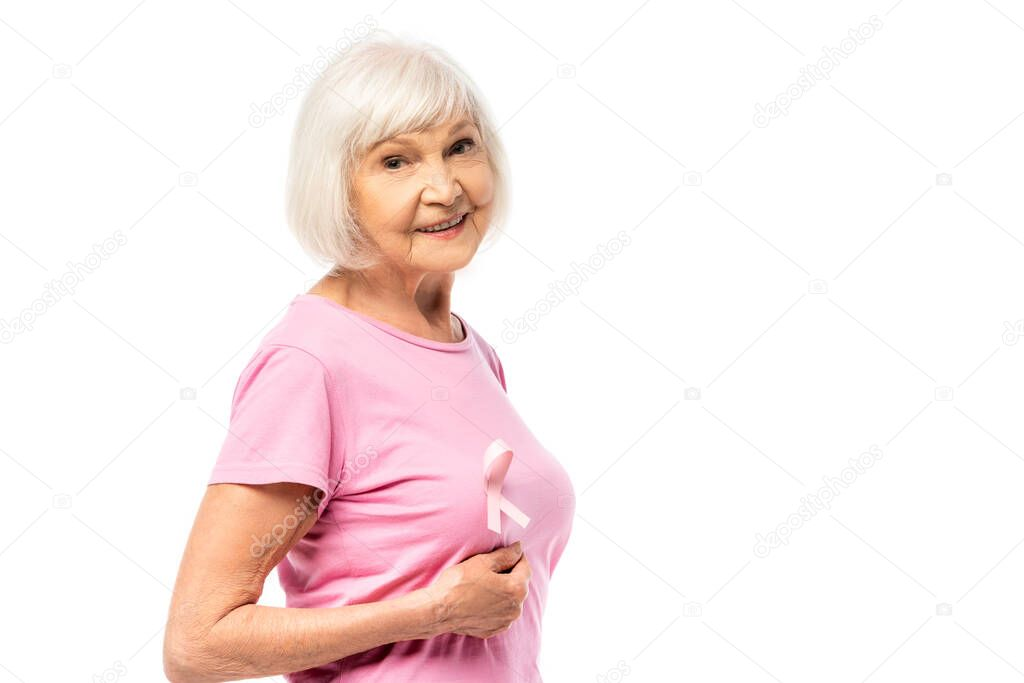 Senior woman looking at camera while touching breast isolated on white, concept of breast cancer stock vector