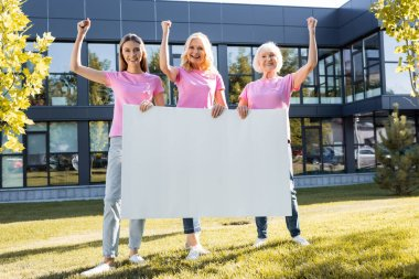 Three women with yeah gestures holding empty board, concept of breast cancer stock vector