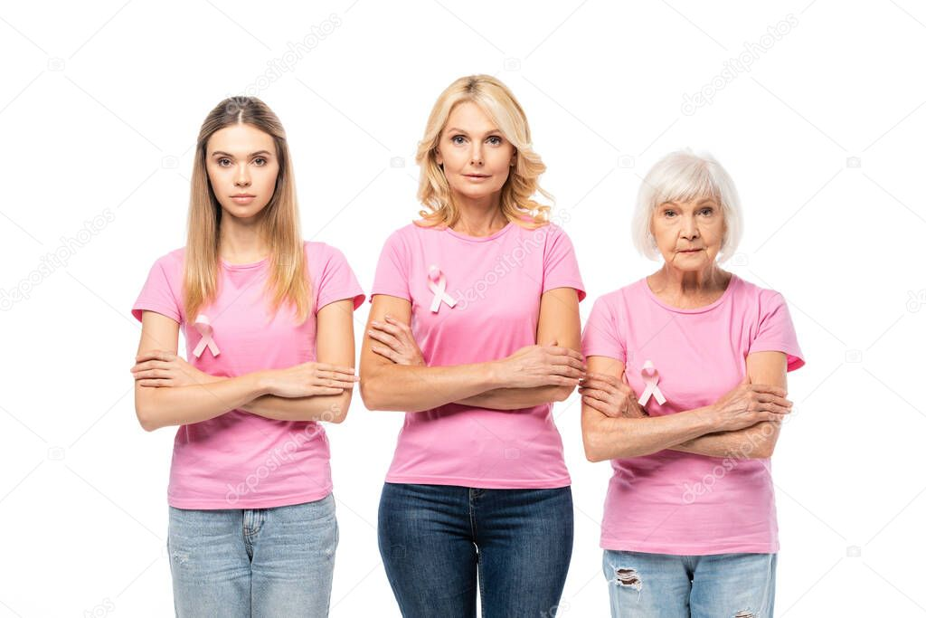 Women with crossed arms and ribbons of breast cancer awareness looking at camera isolated on white stock vector
