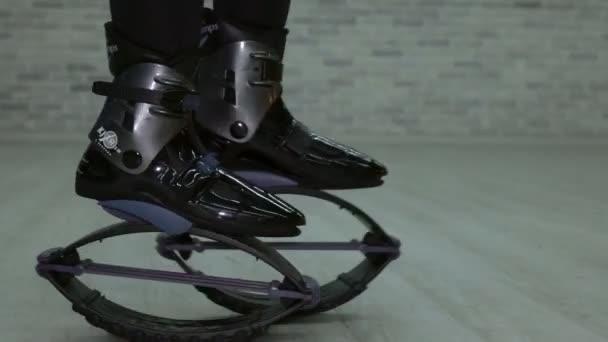 Closeup of sporty girl Kangoo jumps. Sports shoes.