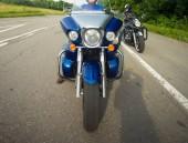 Fotografie bikers sitting on their bikes, big chopper bike, sport bike on road