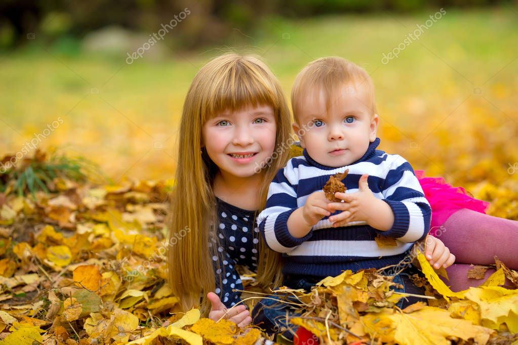 Cute funny children playing in autumn park