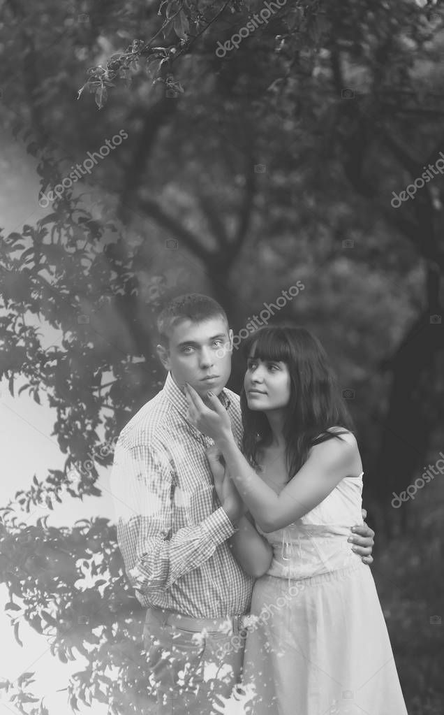 Happy Couple hugging in summer park, black and white