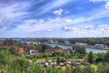 View on and from the Kiel Canal bridge in northern germany on a sunny summer day