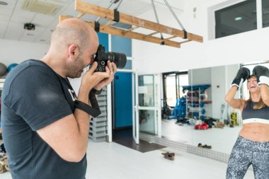 Photographer working in a fitness session