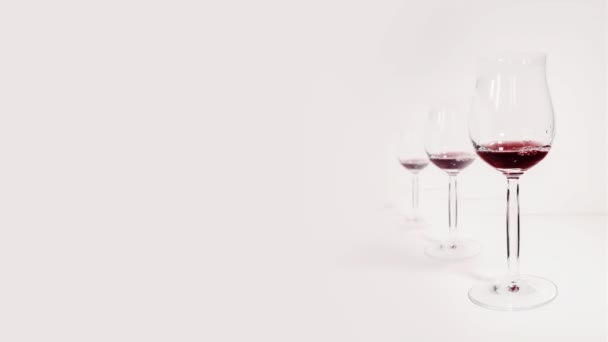 Red wine fills glass goblets