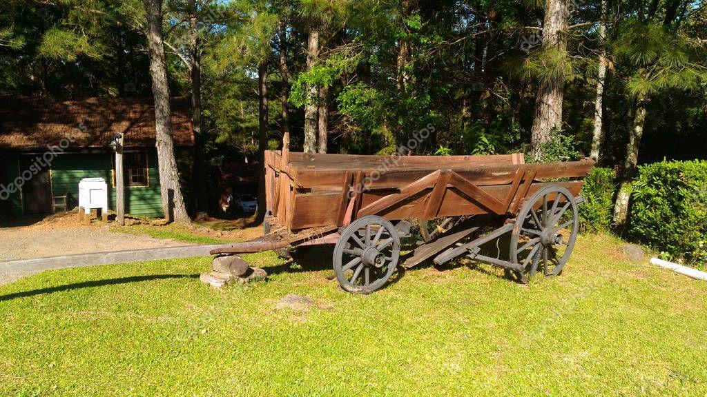 rustic wheelbarrow on a site