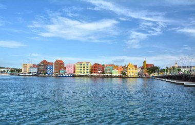 WILLEMSTAD, CURACAO - MARCH 27, 2017: Waterfront with harbour and colorful houses in Willemstad, Caribbean. The city center is UNESCO World Heritage Site.