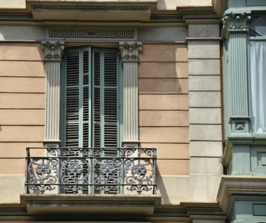 Window with shutters and balcony.