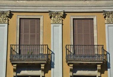 Windows with shutters and balcony.